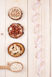 Healthy nutrition. Overhead view of a of different types of nuts and oat in wooden spoon wrapped in measure tape in diet , weight loss and healthy nutrition Royalty Free Stock Image