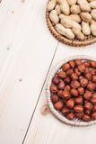 Healthy nutrition. Peanuts and hazelnuts in diet , weight loss and healthy nutrition concept  lying on wooden table with place for text Royalty Free Stock Image