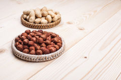 Healthy nutrition. Peanuts and hazelnuts in diet , weight loss and healthy nutrition concept  lying on wooden table with place for text Stock Photography