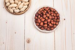 Healthy nutrition. Peanuts and hazelnuts in diet , weight loss and healthy nutrition concept  lying on wooden table with place for text Stock Photos