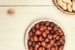 Healthy nutrition. Peanuts and hazelnuts in diet , weight loss and healthy nutrition concept  lying on wooden table with place for text Stock Image