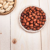 Healthy nutrition. Peanuts and hazelnuts in diet , weight loss and healthy nutrition concept  lying on wooden table with place for text Stock Images
