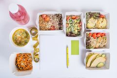 Healthy nutrition plan. Fresh daily meals delivery. Restaurant food for one, vegetable, meat and fruits in foil boxes, detox water. Business card, notebook and Stock Photos
