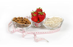 Healthy nutrition strawberry oatmeal and almond. On the light background Royalty Free Stock Image