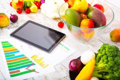 Healthy nutrition and tablet Stock Image