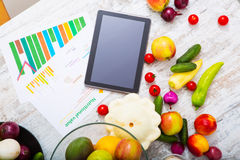 Healthy nutrition and tablet Stock Photos