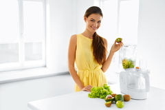 Healthy Nutrition. Woman With Detox Smoothie Juice. Diet Meal Ea. Healthy Nutrition. Closeup Of Smiling Young Woman With Blender Chopping Vegetables For Green stock photos