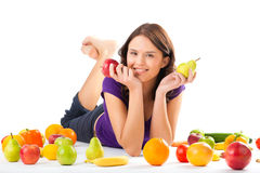 Healthy nutrition - young woman with fruits. Healthy eating, happy woman with fruits and vegetables is eating a apple Royalty Free Stock Photos