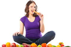 Healthy nutrition - young woman with fruits royalty free stock photo