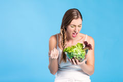 Healthy nutrition - young woman with salad Royalty Free Stock Images