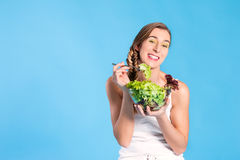 Healthy nutrition - young woman with salad Royalty Free Stock Photos
