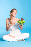 Healthy nutrition - young woman with salad Royalty Free Stock Photography