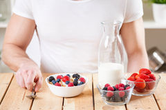 Healthy and nutritious yogurt with cereal and fresh raw berries Stock Photography