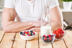 Healthy and nutritious yogurt with cereal and fresh raw berries Stock Photo