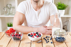 Healthy and nutritious yogurt with cereal and fresh raw berries Royalty Free Stock Photo