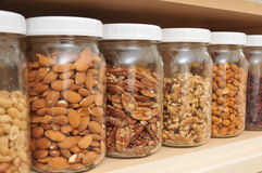 Healthy Nuts in Glass Jars Royalty Free Stock Images