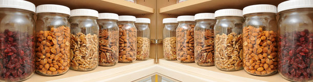 Healthy Nuts in Glass Jars Royalty Free Stock Image