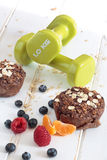 Healthy Oat and apple muffin with fruits and Dumbbells. Diet concept Royalty Free Stock Images