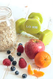 Healthy Oat and apple muffin with fruits and Dumbbells. Diet concept. Stock Photo