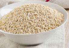 Healthy Oat bran in  white bowl Stock Photos