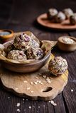Healthy oatmeal balls with chia seeds, cranberries, coconut, flax seeds and honey stock photography
