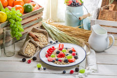 Healthy oatmeal with fresh fruits and milk Royalty Free Stock Photography