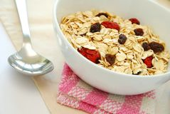 Healthy oatmeal with raisins and dates Stock Photo