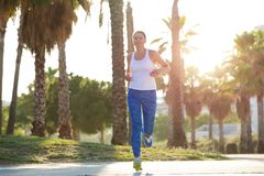 Healthy older woman running outdoors Stock Photos