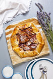 Healthy open apple pie with lavender. and almond milk .French cu Stock Image
