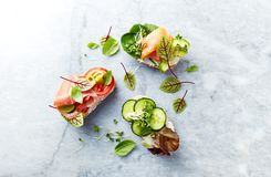 Healthy open sandwiches with vegetables, herbs, salmon, ham, herbs and soft cheese. Healthy diet concept. Healthy open sandwiches with vegetables, herbs, salmon royalty free stock photo