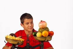 Healthy option. Nutrition balance, educated teenager choosing the healthy option Royalty Free Stock Photo