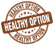 Healthy option brown grunge round rubber stamp Royalty Free Stock Images