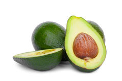 Healthy and organic avocados, isolated on a white background. Ripe avocados from the organic avocado plantation. The Stock Photos