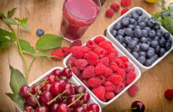 Healthy organic berry fruits and raspberry juice Stock Images