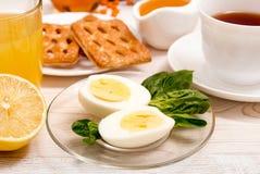 Healthy organic breakfast. Boiled eggs, cup of tea, orange juice Royalty Free Stock Photography