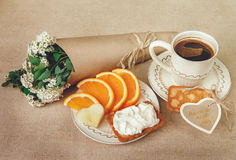 Healthy Organic Breakfast.Cup og Coffee,Cut Orange,Biscuit with Cottage Cheese.Wish Card with Flowers. Toned Royalty Free Stock Photo