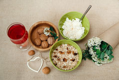 Healthy Organic Breakfast.Walnuts,Oatmeal andC ottage Cheese.Green Ceramic and Wooden Plates.Glass with Red Drink.Wish Heart Card Royalty Free Stock Photos