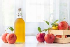 Healthy organic food. Apple cider vinegar in glass bottle. Healthy organic food. Apple cider vinegar in glass bottle and fresh red apples on a light background stock photo