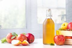 Healthy organic food. Apple cider vinegar in glass bottle. Healthy organic food. Apple cider vinegar in glass bottle and fresh red apples on a light background royalty free stock photo