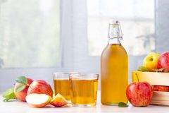 Free Healthy Organic Food. Apple Cider Vinegar Or Juice In Glass Bottle And Fresh Red Apples. Royalty Free Stock Photo - 150929375