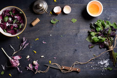 Healthy organic food background, salad radicchio with garden basil, egg and garlic. Copy space, overhead view. Stock Photos