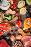 Healthy organic food. Healthy diet background. Organic food ingredients, superfoods: beef and pork meat, chicken filet, salmon fish, beans, nuts, milk, eggs Stock Photography