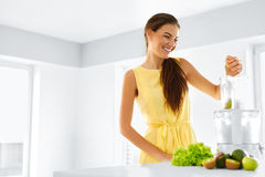 Healthy Organic Food Preparation. Green Juice. Woman Detox Diet. Healthy Organic Food Preparation. Green Juice. Happy Smiling Woman Juicing Vegetables And stock photos