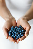 Healthy Organic Food. Woman Hands Full Of Sweet Ripe Blueberries Stock Photo