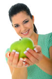 Healthy Organic Fruit. Happy woman offering green apple to camera. isolated on white royalty free stock photography