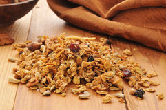Healthy organic granola. Organic granola with rolled oats, almonds, walnuts, sunflower seeds, dried, cranberries, raisins, and brown sugar Royalty Free Stock Image