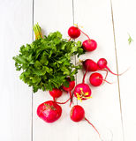 Healthy organic heap of fresh vegetables on a wooden design whit. E background Royalty Free Stock Photo