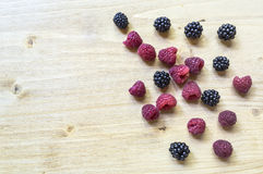 Healthy organic ripe raspberries and blackberries fruit. Stock Photography