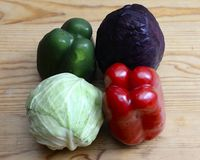 Healthy Organic Vegetables. On a Wooden Background royalty free stock photography