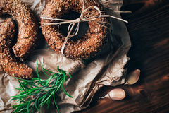 Healthy organic whole grain bagel on wooden table. Breakfast bread. Royalty Free Stock Images